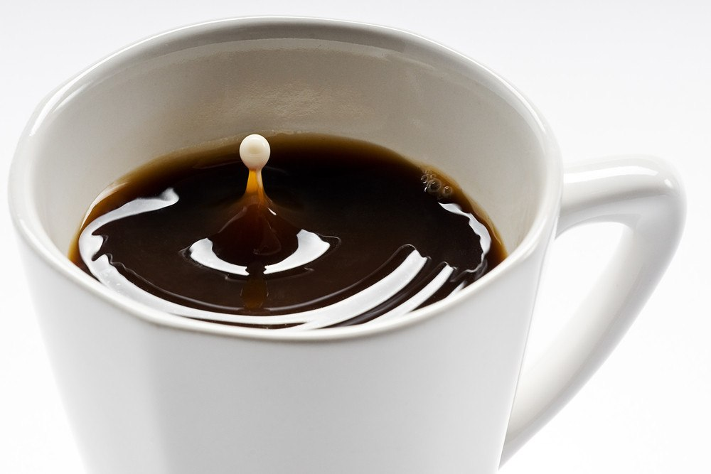A cup of coffee on white background.